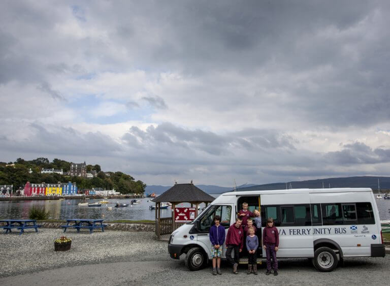 Ulva Ferry Community Transport Bus in Tobermory Harbour, Isle of Mull on a community school trip